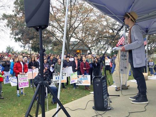 U-Prep senior Zack Jackson, right, gives a speech Saturday