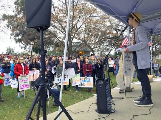 U-Prep senior Zack Jackson, right, gives a speech Saturday to more than 600 students and adults as part of Redding's March for Our Lives rally. Students across the nation demonstrated in support of stricter gun laws in the U.S.