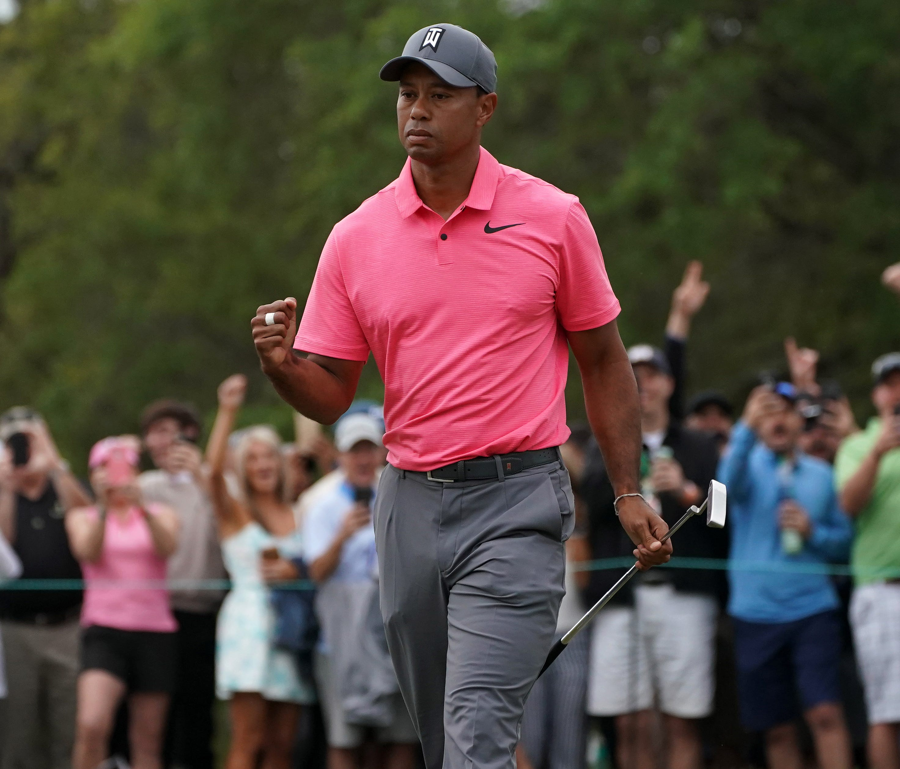 Tiger Woods pumps his fist after making a birdie putt on the 10th during the third round of the Valspar Championship golf tournament at Innisbrook Resort - Copperhead Course.