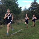 Ryan Talbott of Pinckney edges to the front as the Pirates and Hartland break from the start line in their dual cross country meet on Tuesday at Hudson Mills Metropark. Talbott, who took third, has eventual winner Austin Wicker to his right and second-place Isaac Harris to his left.
