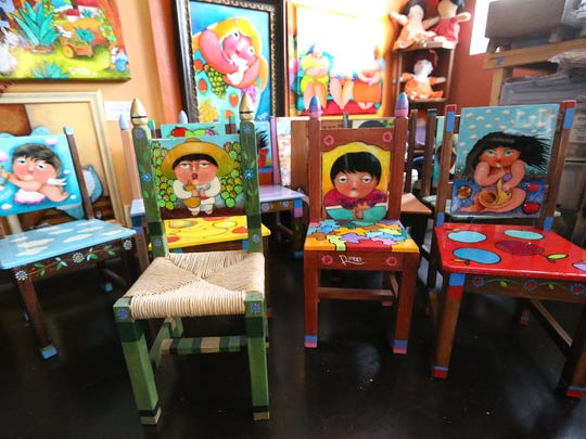 Some of Francisco Romero's work includes brightly decorated children's chairs.