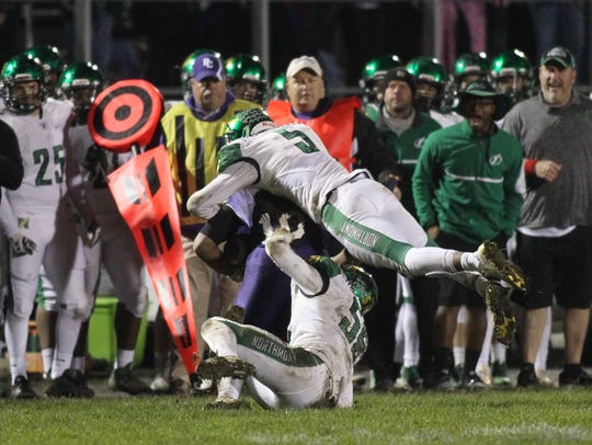 Northmont's Jestin Jacobs makes a tackle against Pickerington