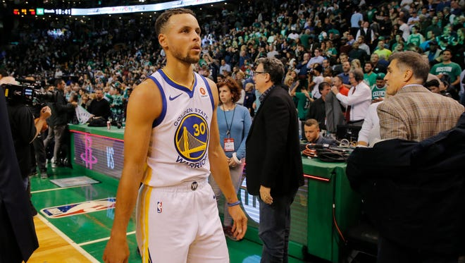 Golden State Warriors guard Stephen Curry (30) looks on while leaving the court after the game against the Boston Celtics at TD Garden.