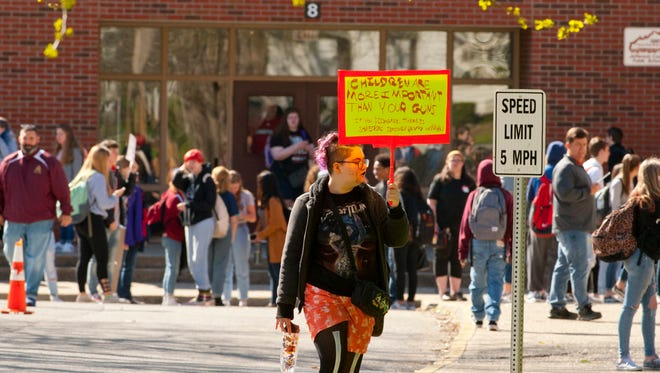 "Atherton High School sophomore Leo Hickerson walks out of her school as she joins other students throughout Louisville, Kentucky and the country in a national school gun violence walkout. Her sign reads ""Children are more important than your guns. If you disagree, there is something seriously wrong with you.""