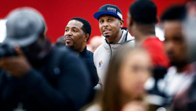 Memphis coach Penny Hardaway (middle) is greeted by fans as he attends a game between Bluff City Legends and the NY Lightning to scout players during the Nike EYBL games in Dallas, Texas.