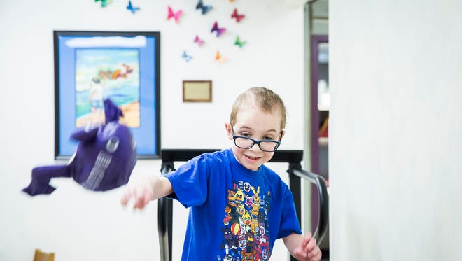 Christian Daugherty works on coordination while on a treadmill during a physical therapy session at Meridian Health Services Pediatric Rehab in Muncie.