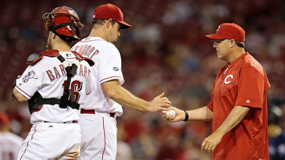Reds manager Bryan Price takes the ball from relief