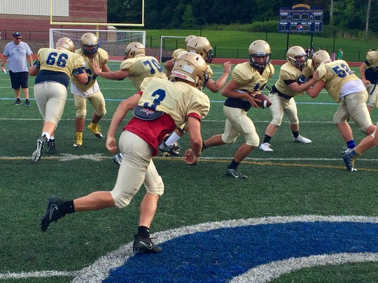 The Our Lady of Lourdes football team practices its