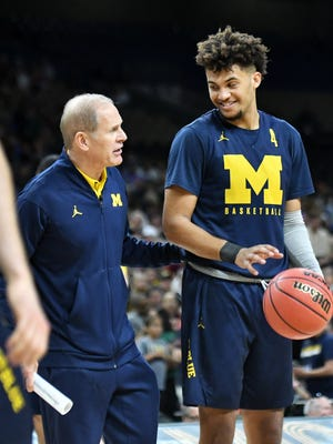 Michigan head coach John Beilein talks with forward Isaiah Livers during the Wolverines' practice Friday.
