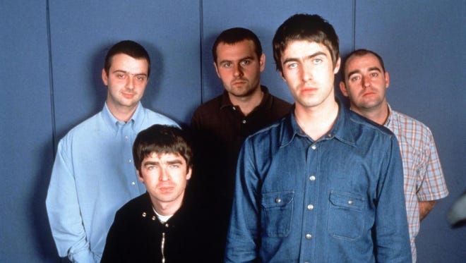 Oasis. Back row: Paul McGuigan, left, Alan White, Paul Arthurs.  Front row:  Noel Gallagher, left, Liam Gallagher.