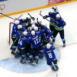 SOCHI, RUSSIA - FEBRUARY 18:  Team Slovenia celebrates defeating Austria 4 to 0 in the Men's Ice Hockey Qualification Playoff game on day eleven of the Sochi 2014 Winter Olympics at Bolshoy Ice Dome on February 18, 2014 in Sochi, Russia.  (Photo by Bruce Bennett/Getty Images)