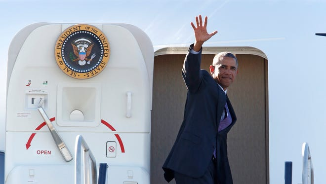 President Barack Obama waves before boarding Air Force One at Westchester County Airport Aug. 29, 2014 in Harrison. President Obama attended two fundraisers in Westchester and returned Saturday for a wedding in Pocantico Hills. (file photo)