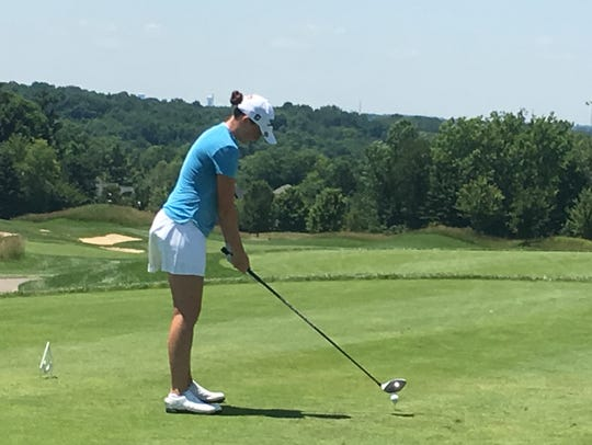 Katie Hallinan of Walnut Hills High School addresses the ball on the first hole at the Prasco Charity Championship. Hallinan now plays in college at Illinois.