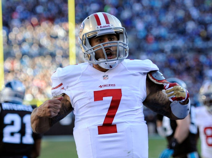 San Francisco 49ers quarterback Colin Kaepernick steals Carolina Panthers quarterback Cam Newton's moves during his touchdown celebration.