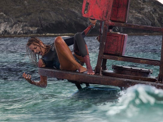 "In ""The Shallows,"" Nancy (Blake Lively) battles for"