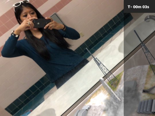 """Using AR technology, the 321 LAUNCH app lets the user """"launch"""" an animated SpaceX rocket in a creative way. To do a 321 LAUNCH selfie, we used a mirror."""