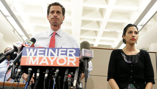 """Anthony Weiner stands beside his wife Huma Abedin as he addresses the media in 2013 during his run to be New York City's mayor. """"Weiner,"""" a new documentary, tracks the ill-fated campaign."""