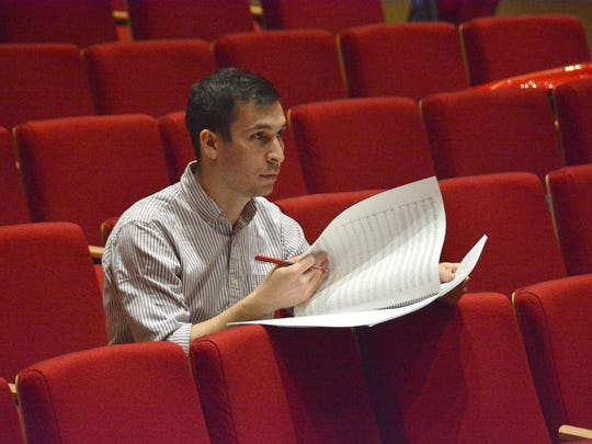 """Composer Ben Kutner is shown during rehearsal Tuesday night with the Northern Dutchess Symphony Orchestra for """"Walkway Over the Hudson."""""""
