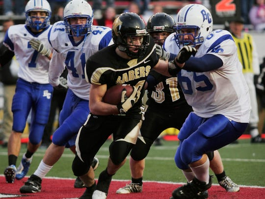 Franklin's DJ Nogalski scoops up a fumble in overtime, ending the Division 2 championship game in 2006 with his Sabers emerging victorious against Brookfield Central, 36-29.