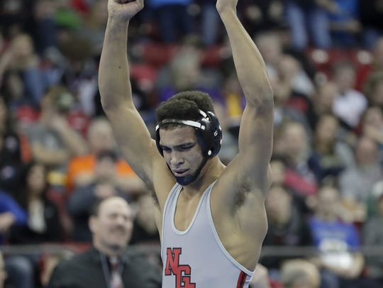 Stephen Buchanan of Neillsville celebrates his win over Jacob Heyroth of Lodi in the Division 2 182-pound final Saturday at the WIAA state wrestling tournament at the Kohl Center in Madison.
