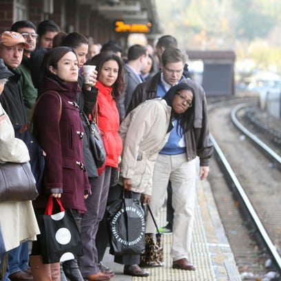 Commuters wait for a New York City-bound Metro-North