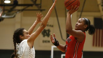 Brianna Love (23 ) of Neptune shoots over Eva Gibson (20)  of Colts Neck during girls basketball game at Colts Neck High School. Colts Neck, NJ. Friday, February 10, 2017. ASB 0211 Girls Hoops Roundup