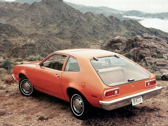 A two-door hatchback model of the Ford Pinto is shown