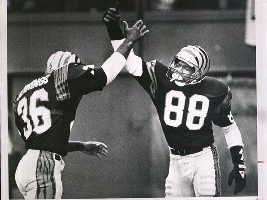 DECEMBER 7, 1987: Bengals receiver Mike Martin, right,
