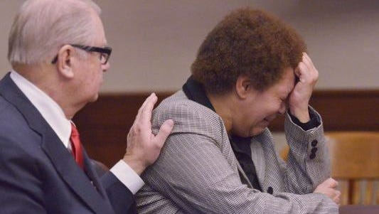 Tewana Sullivan, right, appears in the Livonia courthouse earlier this year.