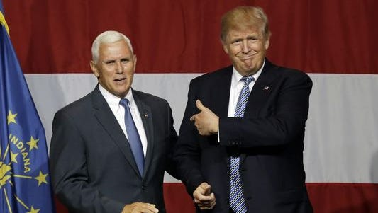 Indiana Gov. Mike Pence, left, has cancelled his speech in Greater Cincinnati this  week.