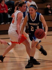 Kelly Tomfohrde of Auburndale, right, as a high school basketball player in November 2008.