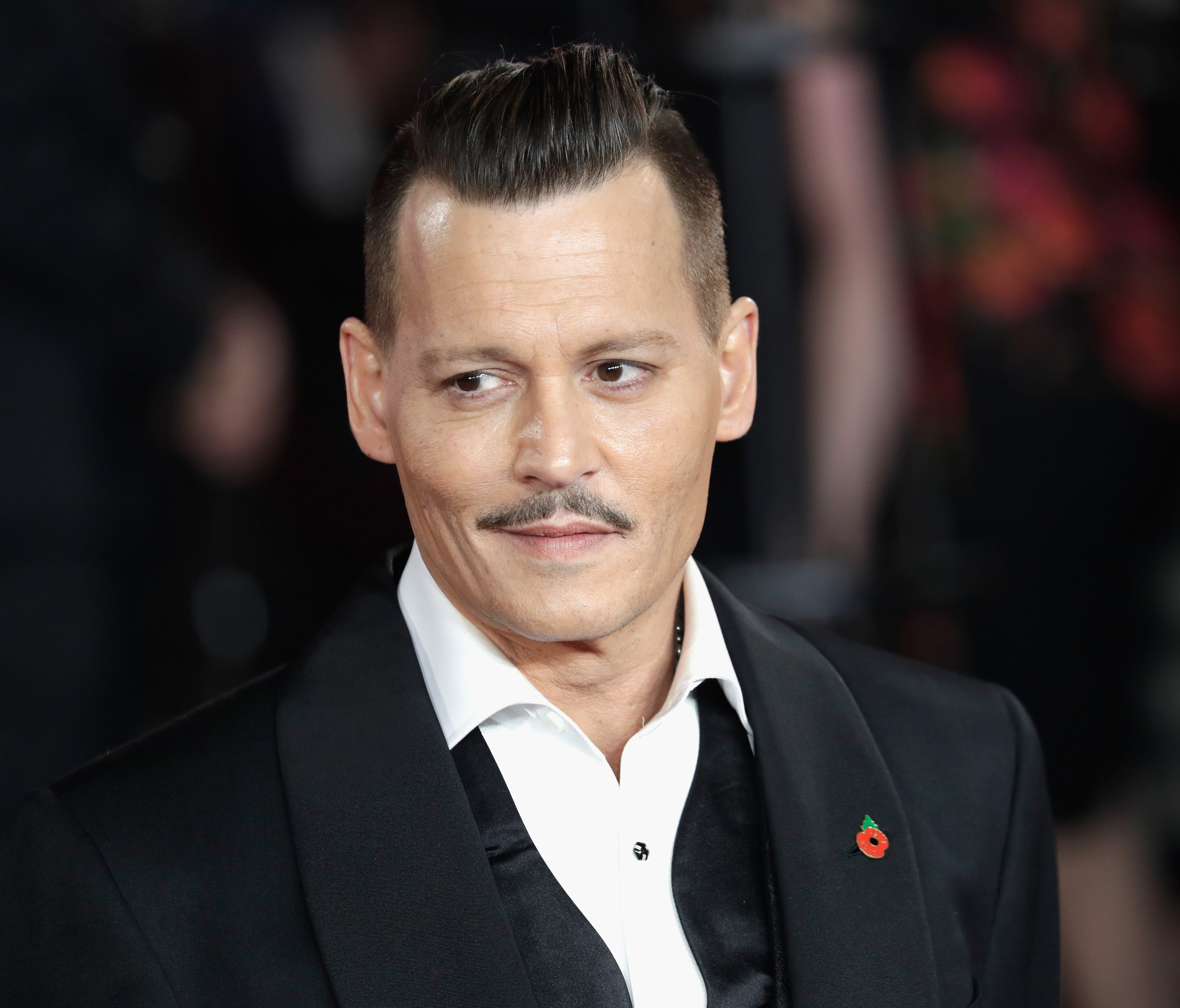 Johnny Depp sported a finely coiffed pompadour at the 'Murder On The Orient Express' premiere on Nov. 2, 2017 in London.