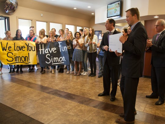 Students from Desert Hills High School, representatives from Chartway Federal Credit Union and the Make-A-Wish Foundation gather to honor Simon McCune, who will be traveling to Finland to see the northern lights Wednesday, Feb. 8, 2017.
