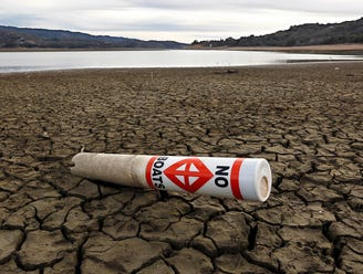 Warning buoys rest on the dry, cracked bed of Lake Mendocino near Ukiah, Calif., on April 1.