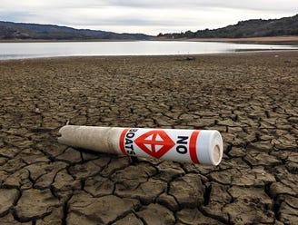 Warning buoys rest on the dry, cracked bed of Lake Mendocino near Ukiah, Calif., on April 1.