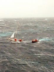 Crew from the Coast Guard Cutter Tamaroa's rigid hull