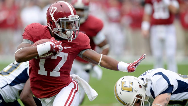 Alabama running back Kenyan Drake (17) carries for a touchdown against Chattanooga during the first quarter Nov. 23 at Bryant-Denny Stadium.