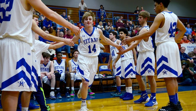 Kevin Silver (14) and the McDowell boys are the first-place team in Mountain Athletic Conference basketball