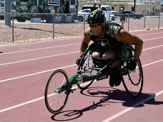 U.S. Army Staff Sgt. Max Hasson, Warrior Transition Battalion, Fort Carson, Colorado, rolls through the line with ease while competing at 2015 U.S. Army Trials MenþÄôs 1500 meter wheelchair event at Fort Bliss, Texas on April 1, 2015.  Approximately 80 wounded, ill, and injured Soldiers and Veterans are at Fort Bliss, Texas to train and compete in a series of athletic events including archery, cycling, shooting, sitting volleyball, swimming, track and field, and wheelchair basketball.     Army Trials, March 29-April 2, are conducted by the Army Warrior Transition Command and hosted by Fort Bliss.     Army trials help determine who will get a spot on the Department of Defense Warrior Games 2015 Army Team in June at Marine Corps Base, Quantico, Virginia. (Photo by Benny Ontiveros, William Beaumont Army Medical Center)