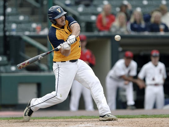 Victor's Chris Varone takes a swing at a pitch during