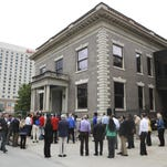 Preservation supporters gathered outside the former Louisville Water Co. building to hear plans for the block on May 21, 2015.