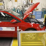A 2016 Volkswagen AG Golf TDI emissions certification vehicle waits to be tested inside the California Air Resources Board Haagen-Smit Laboratory in El Monte, California on Tuesday. Volkswagen's diesel emissions-test cheating in the U.S. wiped about 30 percent off the carmaker's shares last week.