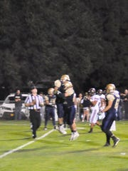 The Ruidoso Warriors celebrate their only touchdown of  night made just before half time,