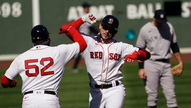 Red Sox first baseman Michael Chavis, center, celebrates his three-run homer in the third inning against the Yankees on Sunday at Fenway Park.