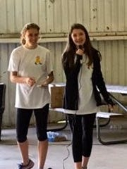 Olivia Mandella and Abby Sheehan congratulate the racers