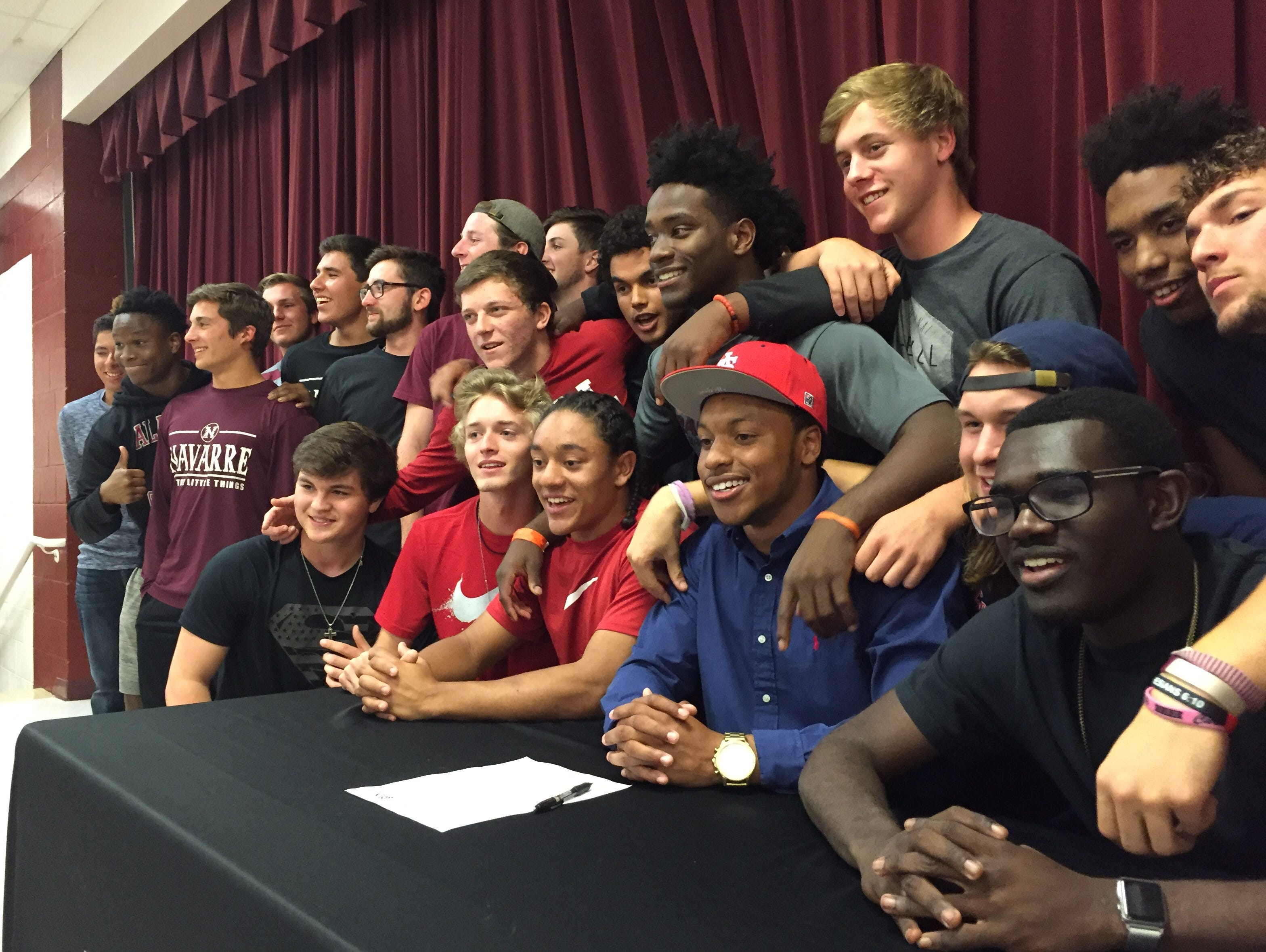 Accompanied by his teammates, Michael Sandle (red South Alabama hat) relishes the moment after signing his letter of intent to play baseball at South Alabama next season.