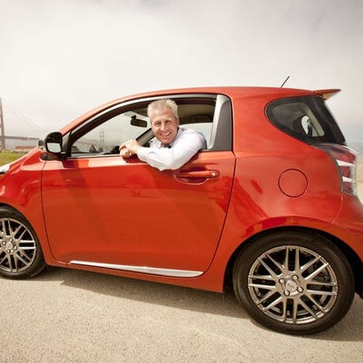 Jack Hollis, Scion vice president, with the iQ.