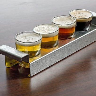 A flight of beer at the original Tap & Screw location in Westwood.