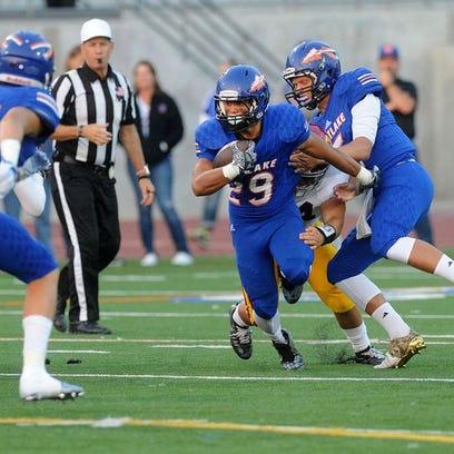 Westlake High's Nathan Brooks makes a run through the Oxnard defense during a non-league game at Westlake High on Friday, August 26, 2016.