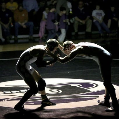 Owen wrestling coach will fight for his job after dismissal